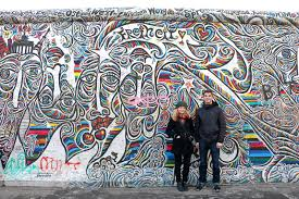 dana reynolds 27 from melbourne australia and john linari 23 from seattle united states on famous berlin wall graffiti artist with the very best art on the berlin wall according to tourists