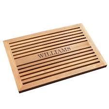 Teak doormat with personalized engraving.