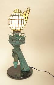 418 contemporary metal with verdigris patina and stained glass statue of liberty torch table lamp unsigned good condition or better
