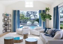 White and Blue living Room with Corner Bookshelf