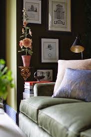 the natchez camel back sofa has fortuny pillows from david duncan on it to add a little shimmer to further enhance the greenery all around the sounds of