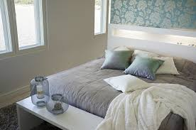 small bedroom with natural light and designer decorated