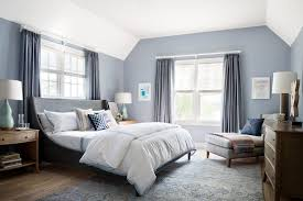 silver blue bedroom transitional with curved bed frame gray table lamps
