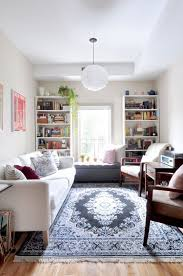 small apartment living room furniture. the traditional rug grounds this midcentury modern apartment tradition with a twist pinterest rugs and mid century small living room furniture