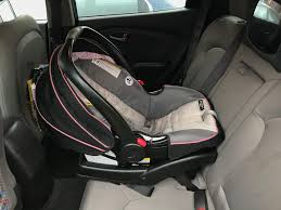 install the car seat in to the base using the connect system do this by setting the car seat on top of the base with the car seat rear facing