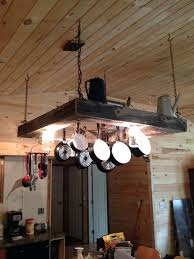 pot rack chandelier rustic light pot and pan rack over the kitchen island my husband made pot rack chandelier