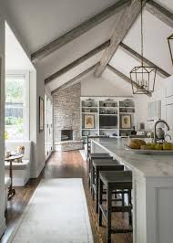 With vaulted ceilings, marble surfaces and crisp white cabinetry, this  contemporary kitchen remodeled by