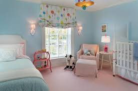 pink and blue nursery with guest bed pin it on view full size