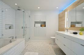 the predominantly white theme continues to the master bath subway tile walls and hexagon tile floors it s sleek and ultra contemporary