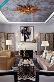 modern chic blue gold brass living room wallpapered ceiling