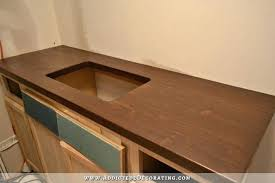 finishing butcher block counters made of pine and stained with dark wood stain sealing butcher block counters