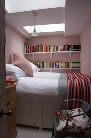 This tiny bedroom is painted in pink farrow & ball paint. Explore our small  spaces