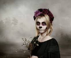 portrait of woman with sugar skull makeup