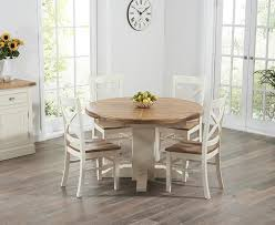 cream compact extending dining table: torino oak amp cream extending pedestal dining table with cavendish chairs