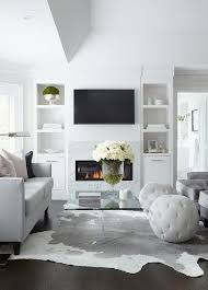 dove gray sofa with white and gray cowhide rug