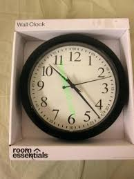 room essentials wall clock appears to be new small wall clock that is approx 9 inches room essentials wall clock