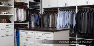 shaker walk in closet with white finish