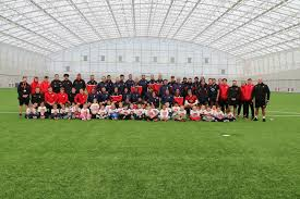 the hong kong team and visitng schoolchildren at the usw sport park