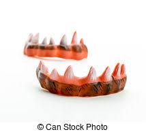 sharp teeth. monster\u0027s ugly sharp teeth isolated on white