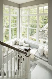 Incredible window seat surrounded by windows in a stairwell