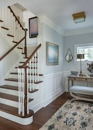cool ikat rug in staircase victorian with modern crown molding next to vaulted ceilings crown moulding alongside weathered wood shingles and chair rail