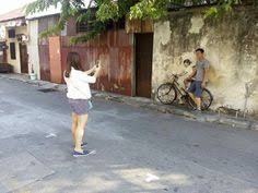 the famous sister and brother cycling mural wall art in penang  on famous wall art in penang with motorcycle boy wall art armenian mural art street penang