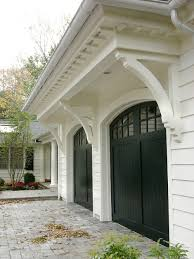 dark brown garage doorswhat color are these garage doors dark brown stain or a black paint