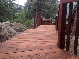 Restored deck with eco-friendly Boodge decking stain in Dark Cedar ...