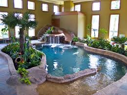 Indoor pool with slide Glass Indoor Beach Entry Freeform Beach Entry Swimming Pool Cave With Waterfall Memphis Pool Swimming Pool Accents Pool Features Personalized Features