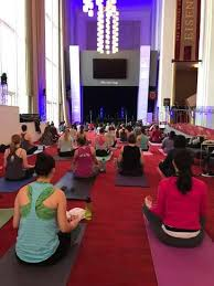 on saay morning roughly 100 yoga mats of all diffe colors were arranged under the crystal chandeliers in the kennedy center s grand foyer