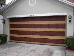i the next two photographs you can see how the rows of panels are done then the second photo shows the completed garage door painted to look like wood