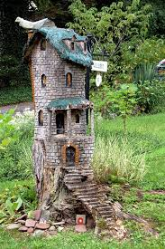 Tree stump carving fairy house! Wouldn't this be sweet tucked into the  corner