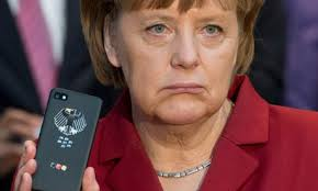 Angela Merkel with phone. Angela Merkel is not happy about the NSA's cellphone coverage. Photograph: Julian Stratenschulte/EPA - Angela-Merkel-with-phone-009