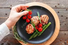 Presentation Foods Restaurant Food Presentation Chef Decorating A Pork Dish Grilled