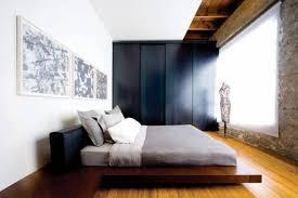beautiful minimalist master bedroom with wood floors