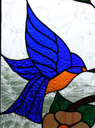 a blue bird in stained glass window