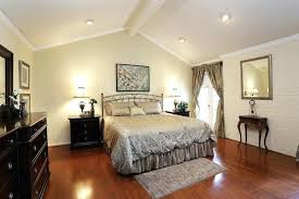 bedroom designed with light wall colors and vaulted ceiling featured recessed lights led recessed lights vaulted