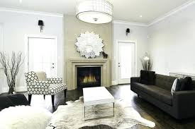 white hide rugs white cowhide rug living room eclectic with animal hide arm chair carved stone white hide rugs