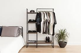 garment rack shelf com iris metal garment rack with wood shelves black and dark brown kitchen