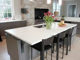 white concrete countertops on kitchen island in modern open kitchen design