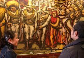 visitors to the chapultepec castle admire siqueiros