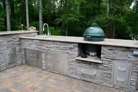 image of best big green egg built into outdoor kitchen
