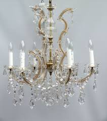 a 6 arm marie therese chandelier with clear kite drops swags and flowers