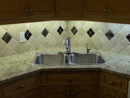 new modern granite tile countertop with custom edging with custom designed diamond pattern tile backsplash