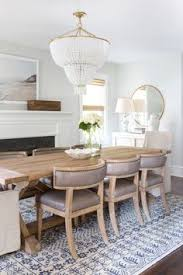 chic dining room design in neutral tones of white being and gray with a