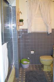before my yellow and gray bathroom when we first looked at the house what you can t see is how dirty those shower doors were