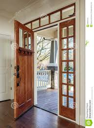 interior shot of an open wooden front door