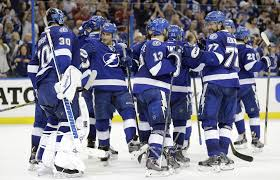 members of the tampa bay lightning celebrate after defeating the montreal canans 4 1 during