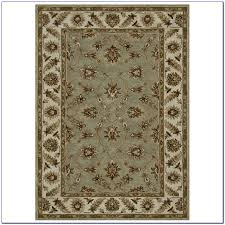 brown and seafoam green area rugs