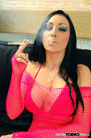 Slutty porn model smoking a long menthol cigarette and playing.
